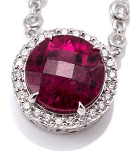Sale 9132 - Lot 443 - AN 18CT WHITE GOLD RUBELITE AND DIAMOND NECKLACE; featuring a round chequerboard cut rubelite tourmaline of approx. 3.94ct to surrou...