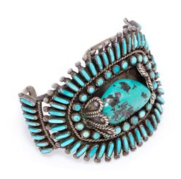Sale 9177 - Lot 351 - A NATIVE AMERICAN TURQUOISE BANGLE SIGNED JMB; cuff bangle centring a 28 x 18mm turquoise with matrix surrounded by round and long o...