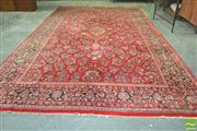 Sale 8255 - Lot 1047 - Large Mashad Wool Carpet, decorated with floral motifs on a red field 564cm x 356cm