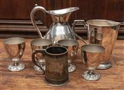 Sale 8942H - Lot 78 - Assorted silver plated drinking wares including an ice water jug, tankard and larger jug and four goblets