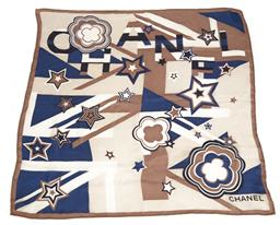 Sale 9090F - Lot 102 - A CHANEL SILK SCARF; blue, fawn and black pattern on a cream ground, machined edge, size 67 x 67cm.