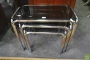 Sale 8277 - Lot 1085 - Nest of Three Metal Tables with Glass Tops