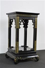 Sale 8402H - Lot 76 - A Chinese two tiered Jardiniere with black lacquered finish and painted detail, height 68cm