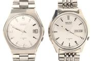 Sale 8517 - Lot 324 - TWO SEIKO STAINLESS STEEL AUTOMATIC WATCHES; ref; 7008-8150 & 70258040 with centre seconds, one with day date, other with date, 17 j...