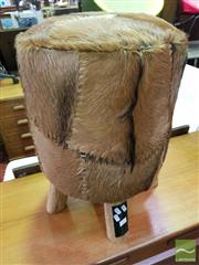 Sale 8550 - Lot 1165 - A Tall Brown Cow Hide Upholstered Stool