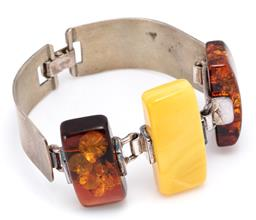 Sale 9164J - Lot 346 - A SILVER DERSIGN AMBER BRACELET; front featuring a rectangular 36 x 15mm butterscotch amber and 2 rectangular  30 x 14-15mm reconsti...