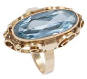 Sale 8965 - Lot 320 - A VINTAGE 9CT GOLD STONE SET RING; set with a long oval cut light blue synthetic spinel to gold scrolling gallery and plain shank, t...