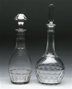 Sale 9144 - Lot 217 - An Orrefors glass decanter together with another (H:32cm and 36cm)