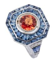 Sale 9054J - Lot 145 - A 14CT WHITE GOLD DECO STYLE GEMSET RING; octagonal mount centring an orange red round cut sapphire of approx. 1.40ct to double surr...