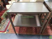 Sale 8637 - Lot 1027 - Pair of Modern Tiered Timber Side Tables on Castors