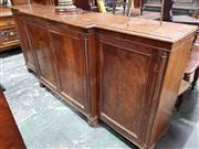 Sale 8956 - Lot 1040 - Large Regency Mahogany Breakfront Cabinet, with four panel doors enclosing fully adjustable shelves, flanked by rope-twist fascia -...