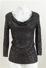 Sale 9081H - Lot 54 - A Bloomingdales sequinned black top in cashmere and silk, size M