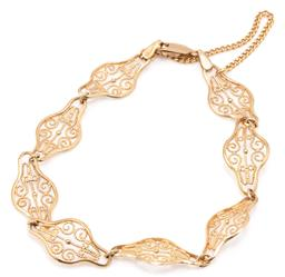 Sale 9160 - Lot 346 - A 9CT GOLD FILIGREE BRACELET; 11mm wide fancy filigree links to parrot clasp with safety chain, length 19cm, wt. 6.07g.