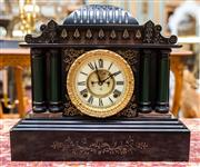 Sale 8287A - Lot 57 - A restored ornate Ansonia cast iron clock with fluted pillars. (Restored & in working order, with key & pendulum).36cm high x 40cm...