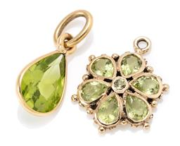 Sale 9164J - Lot 469 - TWO GOLD PERIDOT PENDANTS; a 17ct gold set with a pear cut peridot, size 17 x 7mm, other a floral cluster in 8ct set with a round an...