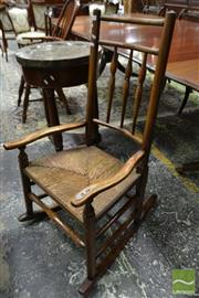 Sale 8500 - Lot 1017 - 19th Century Elm Windsor Style Rocking Chair with Woven Rush Seat