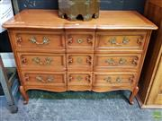 Sale 8629 - Lot 1011 - French style cherry wood three drawer commode