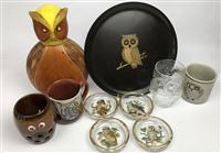 Sale 8725A - Lot 55 - A group of drinking related wares with owl themes including a decanter, glass coasters, mugs and a tumbler and tray.
