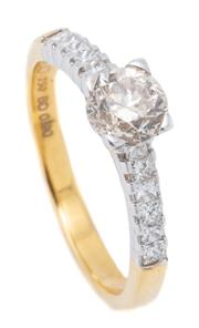 Sale 9054J - Lot 147 - AN 18CT GOLD DIAMOND RING; four claw set with a deep round brilliant cut champagne diamond of approx. 0.90ct P1, above shoulders set...