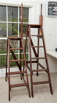 Sale 9090H - Lot 71 - Two timber library ladders, provenance Christies London. One on wheels another with a hand rail, Tallest 151cm