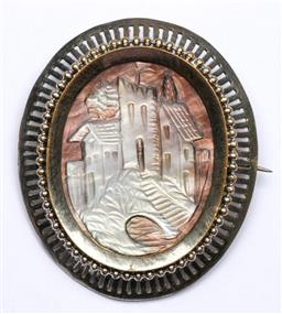 Sale 9156 - Lot 214 - A vintage Mother of Pearl evening brooch, with mansion carving 4cm x 5cm