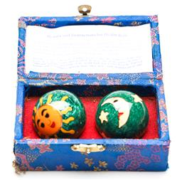Sale 9246 - Lot 70 - A boxed pair of Chinese sun and moon health balls (Dia:4cm)