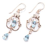 Sale 9020 - Lot 381 - A PAIR OF NOUVEAU STYLE TOPAZ EARRINGS; 9ct gold scrolling frames set with oval cut pale blue topaz to articulated pear cut topaz dr...