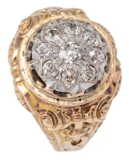 Sale 9124 - Lot 446 - A VINTAGE TWO TONE GOLD DIAMOND RING; featuring a 13mm round cluster top of 9 Old Mine and European cut diamonds totalling approx. 0...