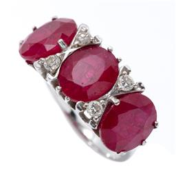 Sale 9213 - Lot 395 - AN 18CT WHITE GOLD RUBY AND DIAMOND RING; bridge ring set with 3 oval cut synthetic rubies adjacent to 4 round brilliant cut diamond...