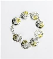 Sale 8196F - Lot 330 - A STERLIING SILVER DAISY BRACELET; featuring 8 pierced links with gold plated highlights (18cm).