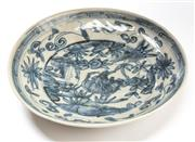 Sale 8517A - Lot 6 - A Chinese porcelain Ming Swatow style plate, D 26.5cm, painted in blue underglaze with deer