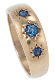 Sale 8965 - Lot 368 - A VICTORIAN STYLE GEMSET RING; 6.7mm wide tapering ring gypsy set in 9ct gold with 3 round cut blue sapphires (abraded), size O, wt....