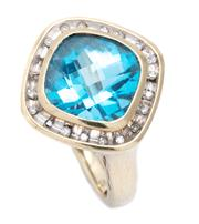 Sale 8982 - Lot 353 - A 9CT GOLD TOPAZ AND DIAMOND RING; featuring a cushion form chequerboard blue topaz of approx. 6ct to a surround of single cut diamo...