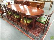 Sale 8251 - Lot 1017 - Rosewood Extension Dining Table & Set of Eight Chairs