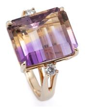 Sale 8999 - Lot 362 - AN AMETRINE AND DIAMOND COCKTAIL RING; featuring a fancy step cut ametrine of 11.04ct to shoulders set with 2 round brilliant cut di...