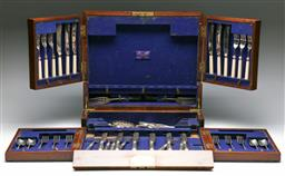 Sale 9164 - Lot 341 - An Edwardian canteen box (35cm x 43cm x 13cm) with contents inc large group of mismatched cutlery (Total 55 pieces) with original key