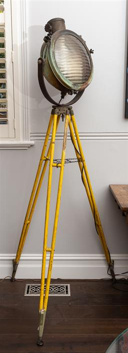 Sale 9160H - Lot 59 - A copper framed spotlight on surveyors tripod stand, total Height 212cm Diameter of light 42cm, in working order, with remote, small...