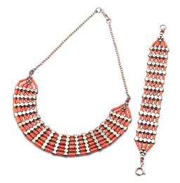 Sale 9182 - Lot 330 - VINTAGE TRIBAL CORAL COLLAR AND BRACELET SUITE; cylindrical coral beads between tribal silver (60%) bars, 25mm wide necklace to silv...