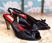 Sale 8474A - Lot 65 - A pair of Diana Ferrari black open toe sling back heels with bow, as new, size 6