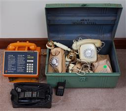 Sale 9103H - Lot 50 - A quantity of telephones including and orange public phone, an early Motorola in a green trunk