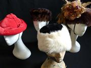 Sale 7982B - Lot 118 - Three fur hats and one red velvet hat