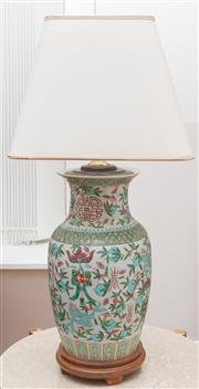 Sale 8530A - Lot 35 - A Chinese pottery lamp enamel painted with fruit, raised on a turned timber stand, H 72cm