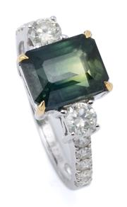 Sale 9054J - Lot 154 - A PARTY SAPPHIRE AND DIAMOND RING; set in 18ct white gold with a 2.94ct party sapphire in green and yellow flanked by 2 round brilli...