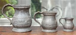 Sale 9120H - Lot 87 - A set of three graduating pewter jugs, Tallest 12.5cm