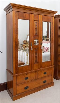 Sale 9260M - Lot 72 - An Edwardian Wardrobe, the two mirrored doors revealing internal hanging space over two short and one long drawer H 209cm W 136cm D...