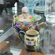 Sale 8231 - Lot 64 - Novelty Ware Teapot And A Hand Painted Wilkinson Jug (2)
