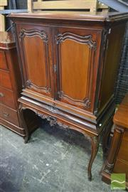 Sale 8255 - Lot 1072 - Early 20th Century Continental Carved Walnut Cocktail Cabinet, with two doors, slide & cabriole legs (key in office)