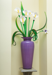 Sale 8677B - Lot 559 - A contemporary lilac baluster vase containing a group of glass cala lilies, height of vase 60 cm