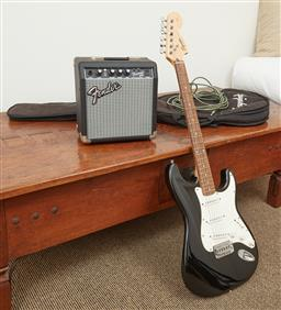 Sale 9108H - Lot 45 - A squire Fender electric guitar serial no. IC050636059 together with a Fender 10G amplifier. serial no. ICTA09005504