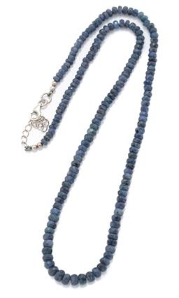 Sale 9209J - Lot 391 - A SAPPHIRE BEAD NECKLACE; slightly graduated strand of 3.6 - 5mm round faceted round blue sapphire beads to a silver clasp, length 4...